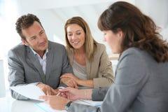 Couple meeting financial advisor. Couple meeting financial adviser for loan granting Stock Photos