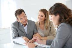 Couple meeting financial advisor Stock Photography