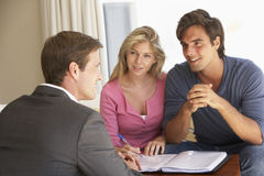 Couple Meeting With Financial Advisor At Home Stock Photo