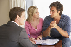 Couple Meeting With Financial Advisor At Home Stock Photography