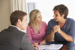 Couple Meeting With Financial Advisor At Home Royalty Free Stock Image