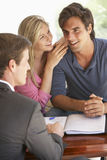 Couple Meeting With Financial Advisor At Home Stock Images