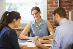Couple Meeting With Financial Advisor In Office Royalty Free Stock Photo
