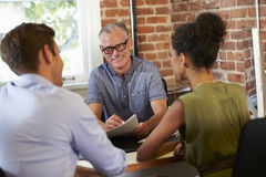 Couple Meeting With Financial Advisor In Office Stock Images