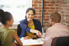 Couple Meeting With Financial Advisor In Office Royalty Free Stock Image