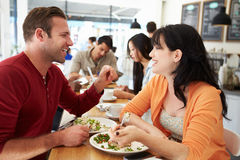 Couple Meeting For Lunch In Busy Caf� Stock Photo