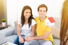 Couple meeting real estate agent at home. Mixed race couple meeting real estate agent at home stock images