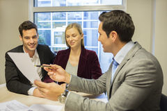 Couple meeting real-estate agent to buy property stock images