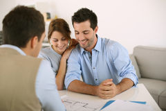 Couple meeting real estate agent Stock Photography