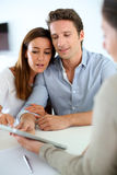 Couple meeting real estate agent. Young couple meeting financial adviser Royalty Free Stock Photos