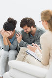 Couple in meeting with a relationship counselor. In her office stock images