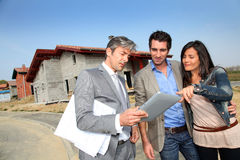 COuple meeting salesman on construction site Stock Photography