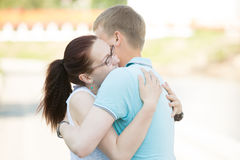 Couple meeting on the street and embracing one another tightly Royalty Free Stock Photos