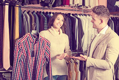 Couple in men's clothes shop Royalty Free Stock Images