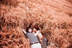 The couple - man and girl lies on the rye field royalty free stock photography