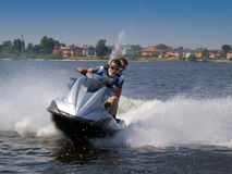 Couple men on jet ski. In the river turns left Royalty Free Stock Photography