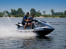 Couple men on jet ski in the river Royalty Free Stock Photography