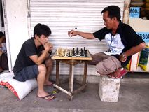A couple of men play chess Stock Images