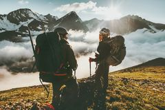 Couple man and woman climbing mountains together. Couple men and women climbing mountains together love and Travel adventure Lifestyle wanderlust concept summer Stock Photo