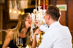 Happy couple in restaurant eat fast food Stock Photos