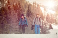 Couple man and woman skier exploring snowy land walking and skiing with alpine ski. Europe Alps. Winter sunny day, snow Stock Images