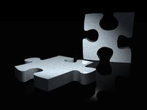 Couple of metal puzzle pieces Royalty Free Stock Photos