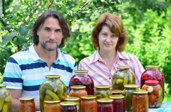 Couple of middle age with homemade preserves and jams Royalty Free Stock Image
