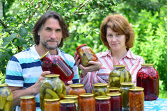 Couple of middle age with homemade preserves and jams Stock Images