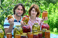 Couple of middle age with homemade preserves and jams Royalty Free Stock Photography