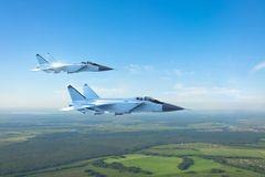 Free Couple Military Jet Fighter Aircraft, Flying Above Ground Stock Image - 136695641