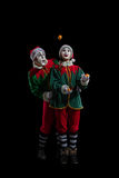 Couple of mimes in New Year costumes isolated stock images