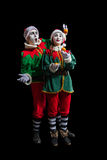 Couple of mimes in New Year costumes isolated royalty free stock image