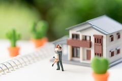 Free Couple Miniature 2 People Standing Model With House Model Make F Royalty Free Stock Photo - 129832435