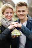 Couple with miniature house Stock Photos