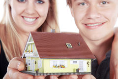 Couple with miniature house Royalty Free Stock Photography