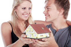 Couple with miniature house Stock Image