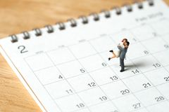 Couple Miniature 2 people standing on Calendar. Day 14 meets Val stock photography