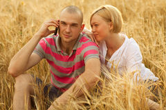 Couple with a mobile phone Royalty Free Stock Photos