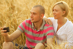 Couple with a mobile phone Stock Image