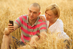 Couple with a mobile phone Royalty Free Stock Photography