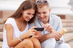 Couple with mobile phone Royalty Free Stock Image