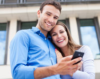 Couple with mobile phone Royalty Free Stock Photos