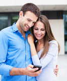 Couple with mobile phone Royalty Free Stock Photo