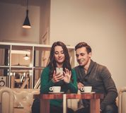 Couple with mobile phone Stock Images
