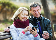 Couple with mobile phones Stock Photos