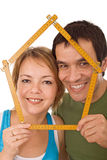 Couple with model house Stock Image
