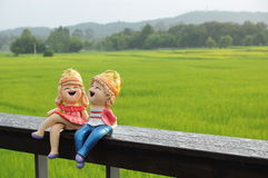 A couple of model sitting together in the rice field Stock Photography