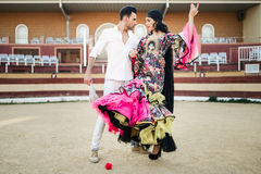 Couple, models of fashion, in a bullring Royalty Free Stock Images
