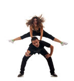 Couple of modern dancers. Posing over white background Stock Photography