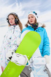 Couple modern  fun snowborder girls Royalty Free Stock Photos